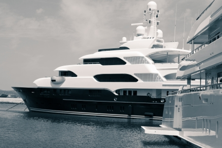 Luxury yachts in port, digitally retouched and toned photo.