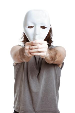 Bizarre man holding white mask, isolated on white background. Stock Photo - 14589685