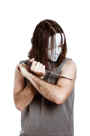 Creepy masked man with knife, isolated on white background. photo