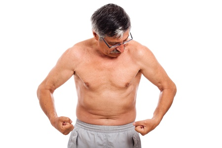 senior man looking at his muscles, isolated on white background. photo