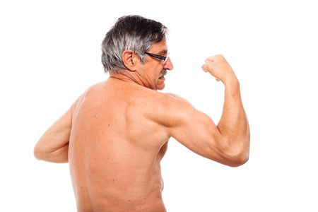 Active senior man posing to show his biceps, isolated on white background. Stock Photo - 14589165