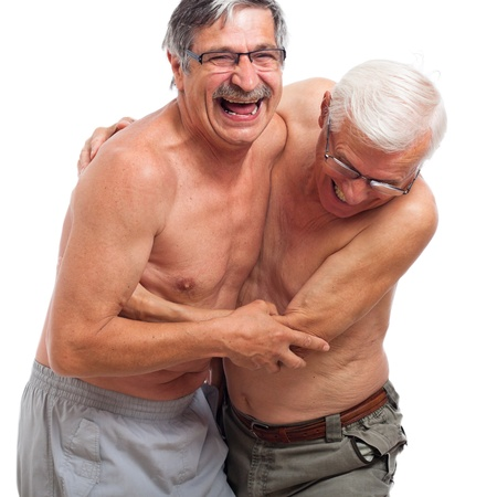 Two naked seniors laughing and fighting for fun, isolated on white background. Stock Photo - 14589170