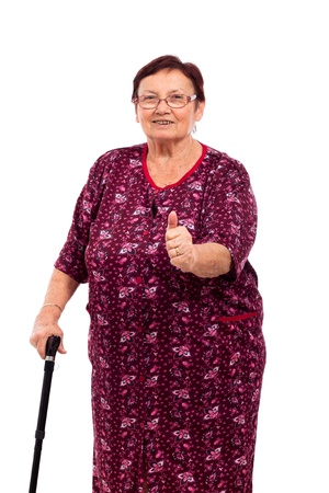 Portrait of happy smiling senior woman with thumb up, isolated on white background.