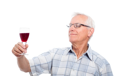 Happy senior man tasting wine, isolated on white background. photo