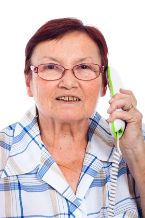 Close up of happy senior woman on the phone, isolated on white background. photo