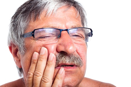 Close up of senior man face with toothache, isolated on white background. Stock Photo - 14589720