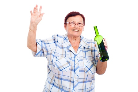 booze: Happy senior drunk woman with bottle of alcohol, isolated on white background. Stock Photo