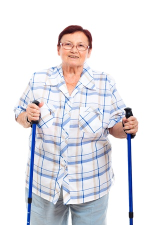 Portrait of happy smiling senior woman with walking sticks, isolated on white background. photo