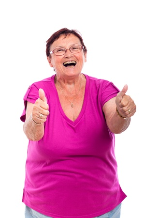 Happy laughing senior woman gesturing thumbs up, isolated on white background. photo