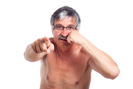 Aggressive senior man gesturing with fist and pointing at you, isolated on white background. Stock Photo - 14715618