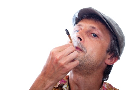Photo of man smoking hashish joint, isolated on white background. photo