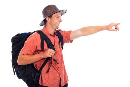 happy young man: Happy young man traveling with backpack pointing the way, isolated on white background with large copy space. Stock Photo