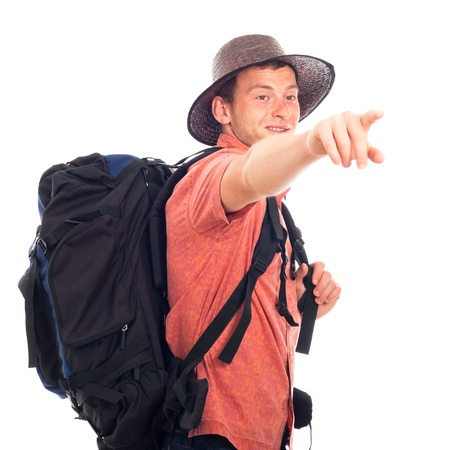 Young man traveling with backpack and pointing the way, isolated on white background with large copy space. photo