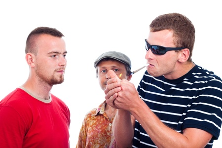 Three young guys going to smoke hashish joint, isolated on white background. Stock Photo - 14715635