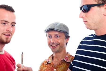 doped: Three young excited guys sharing hashish joint, isolated on white background.