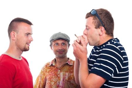 doped: Three friends smoking hashish joint, isolated on white background. Stock Photo