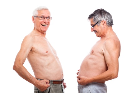 Two happy nude senior men comparing belly, isolated on white background. photo