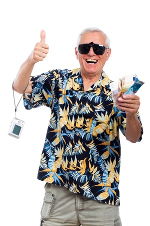 Happy excited senior holding money and camera gesturing thumbs up, isolated on white background.