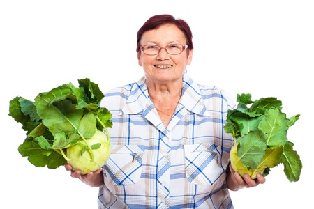 Happy smiling senior woman holding kohlrabi, isolated on white background. photo