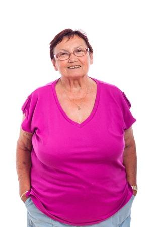 blithe: Retrato de la mujer mayor feliz sin preocupaciones, aislados en fondo blanco. Foto de archivo