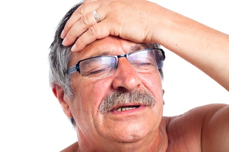 Close up of senior man with headache, isolated on white background. photo