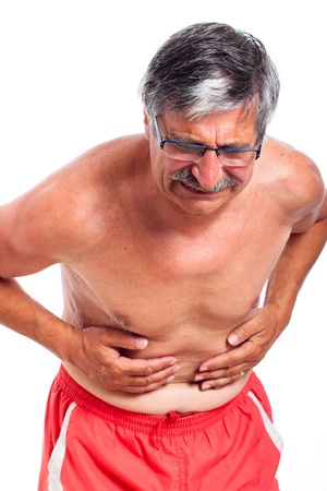 stomach flu: Senior man with stomach ache, isolated on white background. Stock Photo