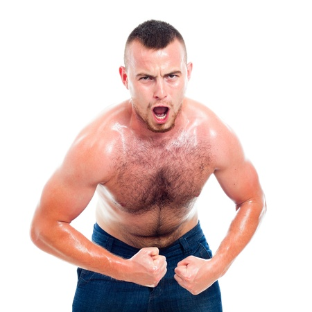 Angry young muscular sports man, isolated on white background. photo