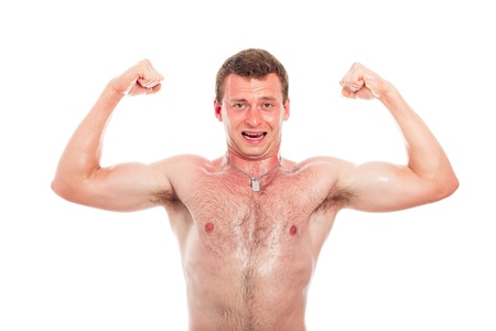Young muscular sports man showing biceps, isolated on white background. Stock Photo - 14779661