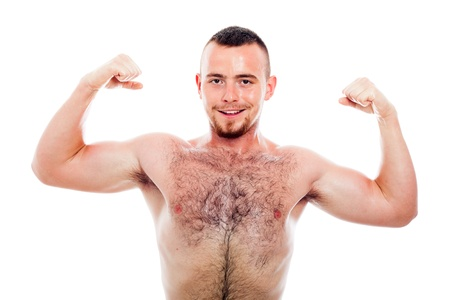 Young smiling muscular sports man showing biceps, isolated on white background.