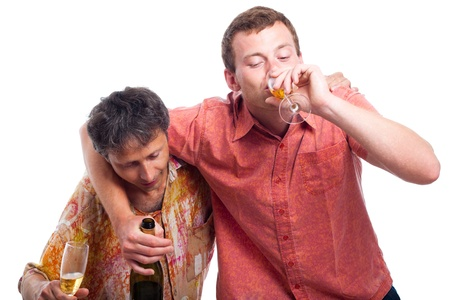 Two drunken men drinking alcohol, isolated on white background. Stock Photo