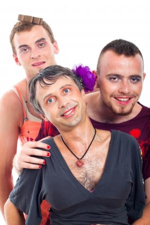 Portrait of three funny transvestites, isolated on white background. photo