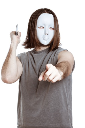 slayer: Scary masked man with knife, pointing at you, isolated on white background. Stock Photo