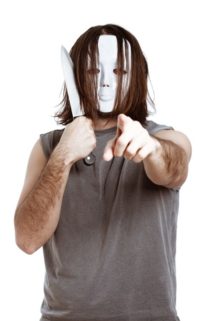 Bizarre masked man with knife, pointing at you, isolated on white background. photo