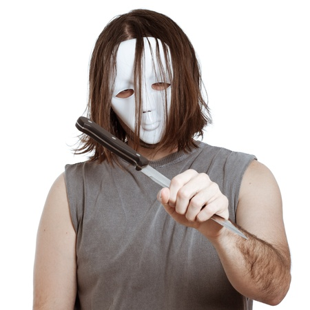 Scary masked man holding knife, isolated on white background. photo