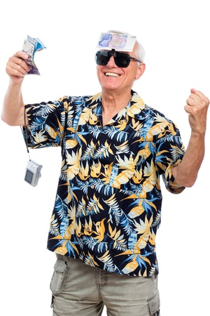Happy wealthy senior man holding money and camera, isolated on white background. photo