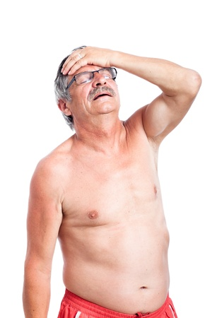 Unhappy shirtless senior man with headache, isolated on white background.