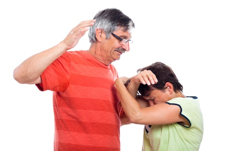 beaten woman: Domestic violence abuse concept, middle aged couple fighting, isolated on white background.