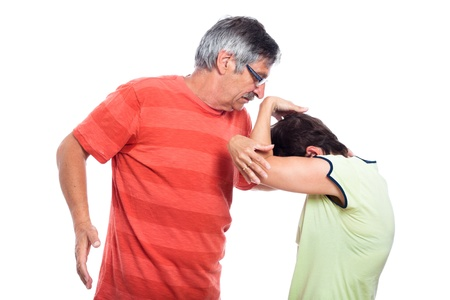 social issues: Domestic violence concept, middle aged couple fighting, isolated on white background.