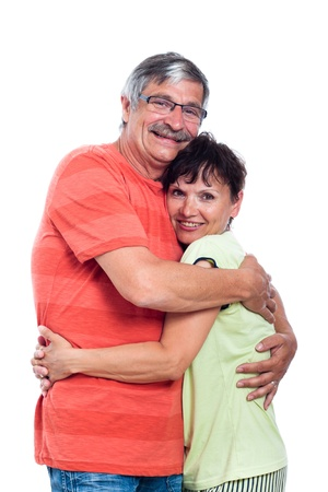 Portrait of happy middle aged couple in love, isolated on white background. Stockfoto