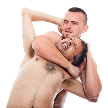 catch wrestling: Two aggressive men wrestling, isolated on white background.