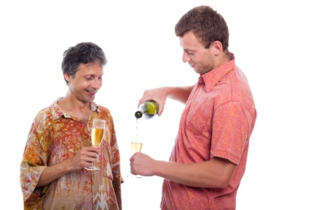 Two men celebrating with champagne, isolated on white background.
