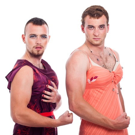 Cross-dressing concept, portrait of two transvestites showing muscles, isolated on white background. Stock Photo