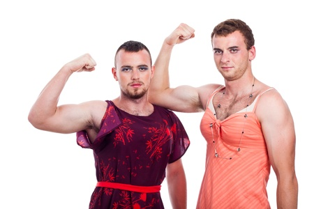 shemale: Cross-dressing concept, portrait of two young transvestites showing biceps, isolated on white background.
