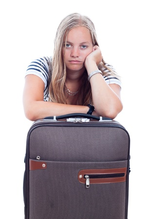 Bored young traveller tourist woman waiting with luggage, isolated on white background. photo