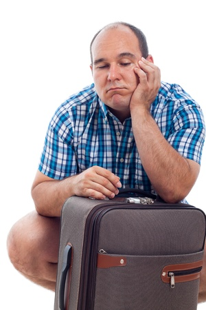 fat person: Bored traveller tourist man waiting with luggage, isolated on white background.