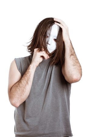 Bizarre horror masked man, isolated on white background. photo
