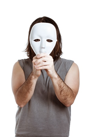 Scary man holding white mask, isolated on white background. photo