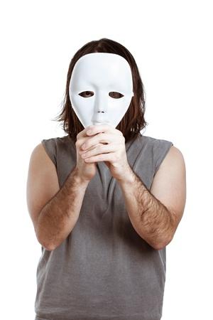 Scary man holding white mask, isolated on white background. Stock Photo - 15288401