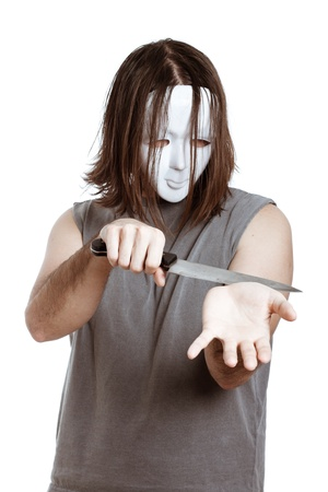 Scary masked man with knife attempting suicide, isolated on white background. photo