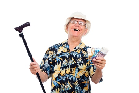 Happy excited wealthy senior man holding money and cane, isolated on white background. photo